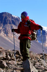 Scientist Jaakko Putkonen uses trekking poles to make his way across the rocky terrain in the McMurdo Dry Valleys