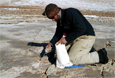 Greg Balco collects a rock sample Jan. 10th while conducting fieldwork in the McMurdo Cry Valleys