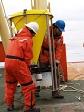 USAP marine science personnel prepare to deploy a sediment trap off the side of the NBP