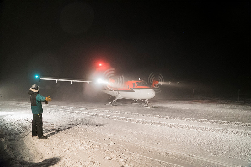 A Twin Otter aircraft on a medical evacuation flight taxis on the skiway at NSF's Amundsen-Scott South Pole Station